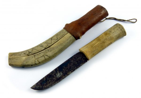 A Saami knife with a steel blade, reindeer antler handle, and a sheath of leather and reindeer antler with an incised decoration