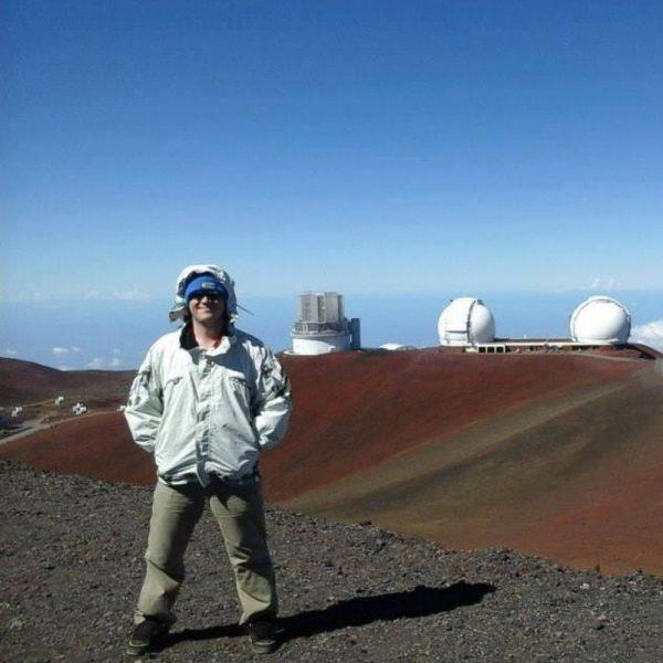 Image of Dan Batchelder on a Mountain Working
